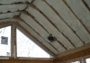 Foam installation sprayed in sunroom vaulted ceiling